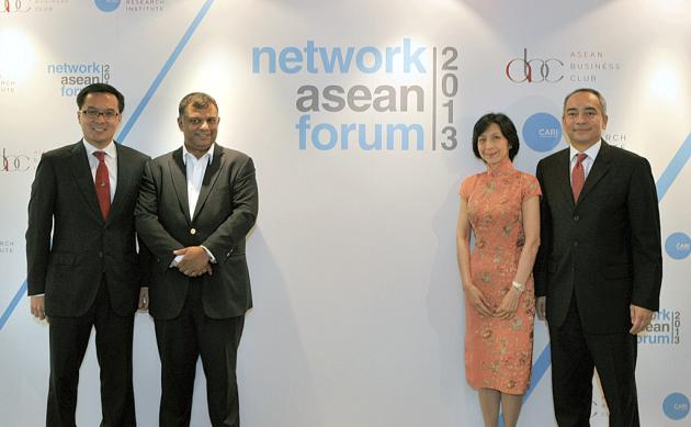 A media conference is held to launch the inaugural Network Asean Forum. From left to right are NAF chairman Patrick Walujo, managing partner of Northstar Pacific Group; AirAsia group CEO Tony Fernandes; and two NAF convenors, Straits Trading Co executive
